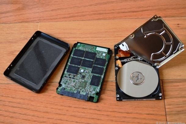 Inside an SSD (left) and spinning hard drive (right).