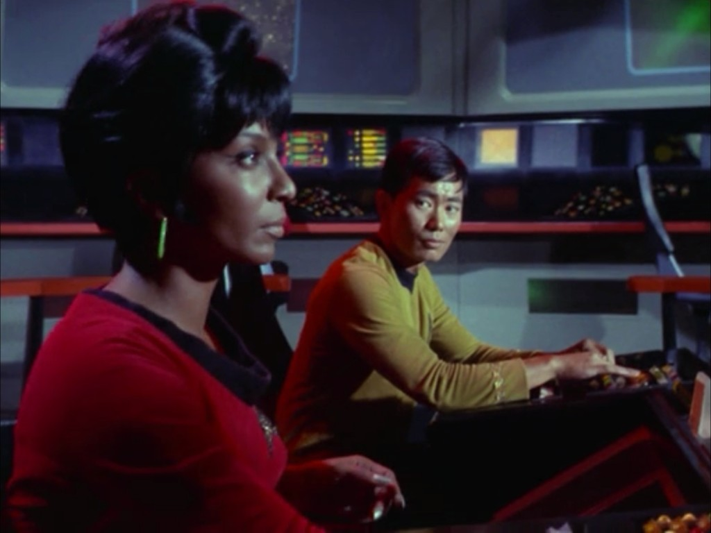 A reminder of why Star Trek TOS was so radical for its time. Two people of color, one of them a woman, piloting the Enterprise during one of its most important conflicts. This is one of my favorite stills.
