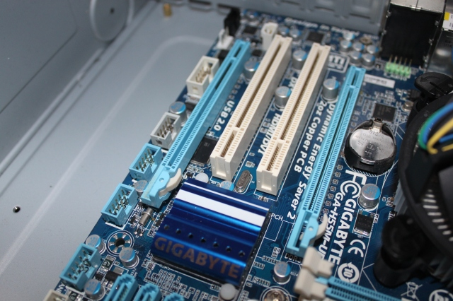 The longer blue slots are the PCIe slots, which will take modern graphics cards. The shorter ones are older generations of PCI.