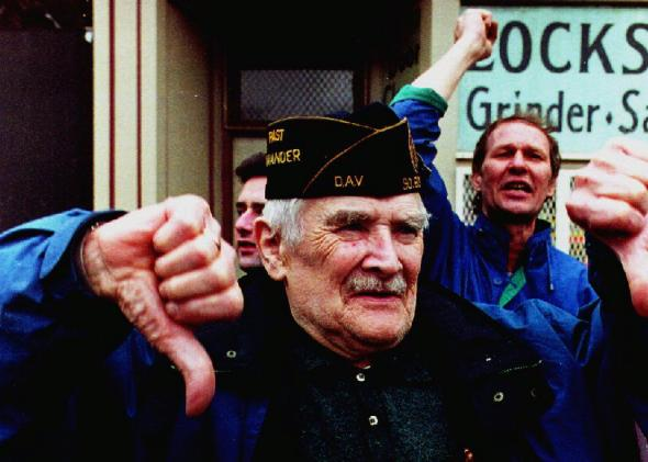 Spectators react to the Irish American Gay, Lesbian, and Bisexual Group of Boston during their appearance in the 1993 South Boston St. Patrick's Day Parade. Subsequently, theSupremeCourt recognized the organizers' right to exclude groups. Photo by John Mottern/AFP/Getty Images via Slate.