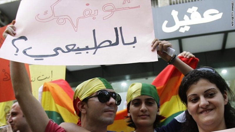 "Protestors gathered in Beirut, Lebanon at the International Day Against Homophobia in 2010. Their sign reads, ""What do you know about normal?"" via muftah.org"