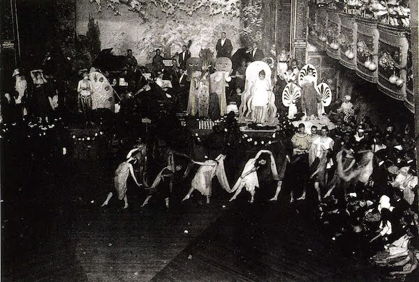 A SCENE FROM THE FUNMAKERS DRAG BALL IN 1940S NYC