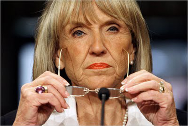 ARIZONA GOVERNOR JAN BREWER - HAIR DOWN, GLASSES OFF.