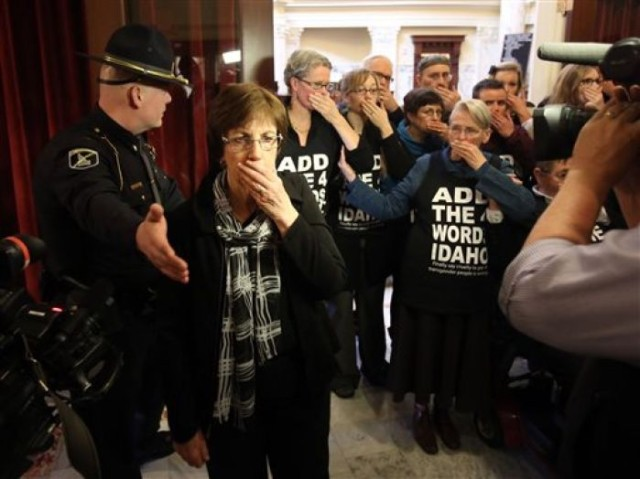 Protesters blocking the entrance to the Senate Chambers in Boise via magicvalley.com