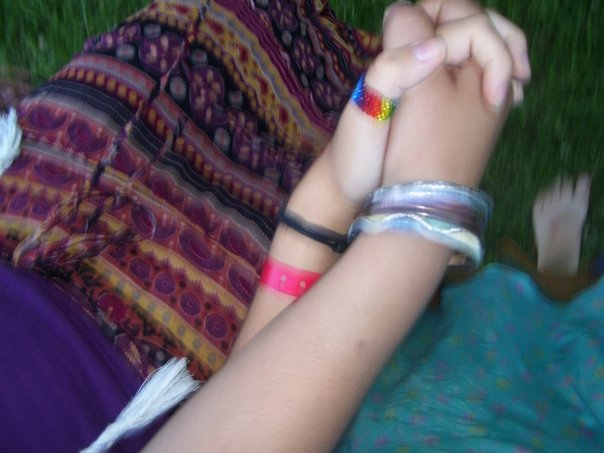 My hand is the one with the very straight rainbow thumb ring on it.