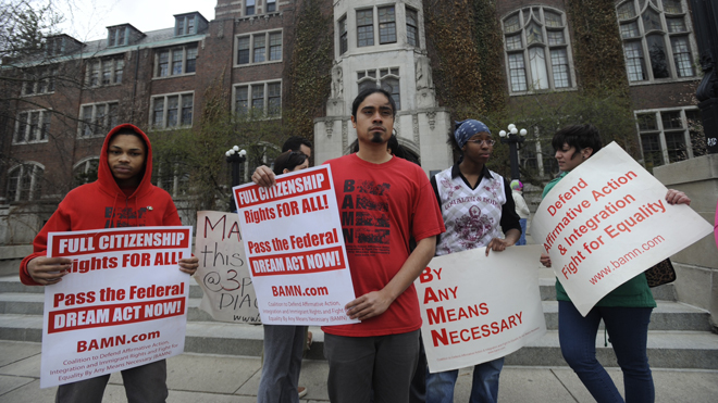 Jose Alvarenga, center, BAMN (By Any Means Necessary) national organizer, and others protest the Supreme Court ruling on the campus of the University of Michigan Tuesday, April 22, 2014, in Ann Arbor, Mich. The justices ruled 6-2 that Michigan voters had the right to change their state constitution in 2006 to prohibit public colleges and universities from taking account of race in admissions decisions. (AP Photo/Detroit News, David Coates ) DETROIT FREE PRESS OUT; HUFFINGTON POST OUT.