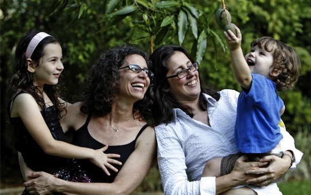 I am sure these amazing lesbian mamas would think twice before invading the privacy of their adorable children. (Via Miami Herald)