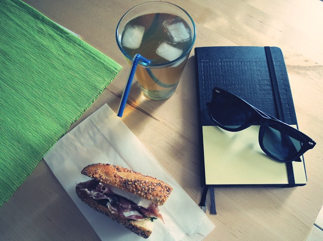 Evidently, no Moleskine is complete without a tinted filter, an artistically posed pair of Ray-Bans, and a tasty-looking sandwich. (Via The Stradivariusisters)