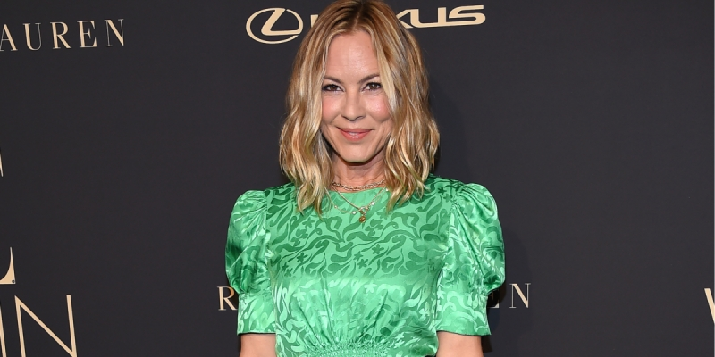 Maria Bello in a green dress at a red carpet event in Los Angeles