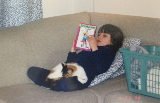 A baby Maddie Taterka (Autostraddle Contributing Editor) with her baby kitteh.