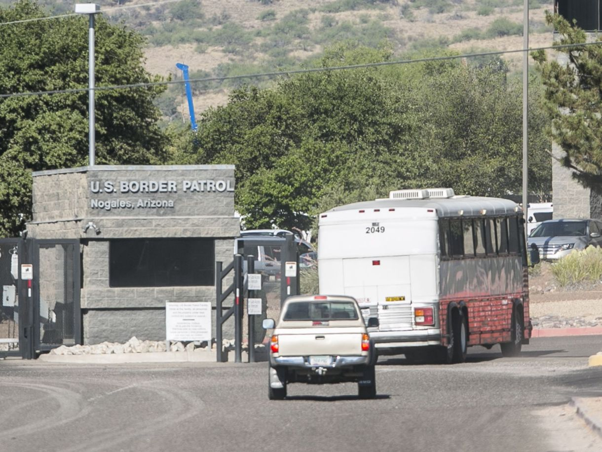 A bus carrying detainees enters the Nogales Border Patrol Station. via AZ Central