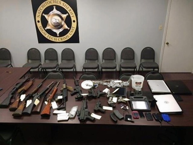 The firearms and computer equipment recovered from the residence.
