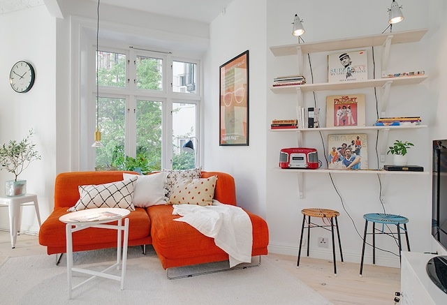 If I owned this sweet orange sofa, I might feel differently about watching television. (Via Zirla)