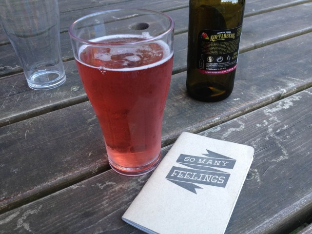 Here, my Autostraddle notebook poses seductively with a fruity cider.