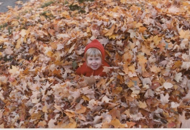 Riese in a pile of leaves circa 1984
