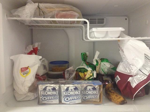 Still life with Klondike bars, banana, and frozen vegetables.