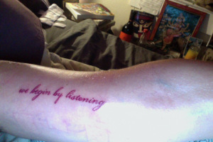 Leah_We_begin_by_listening_tattoo