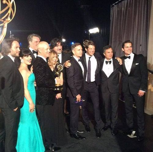 Ryan Murphy holds the Emmy along with cast members of The Normal Heart.