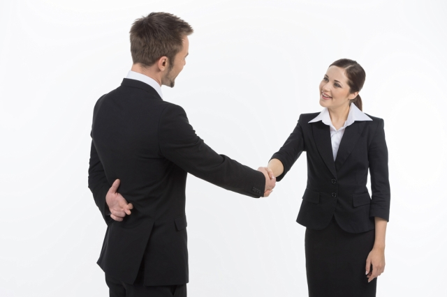 Advice for stock photography businesswomen: always check behind your negotiation partner's back before agreeing to anything. Via Shutterstock.
