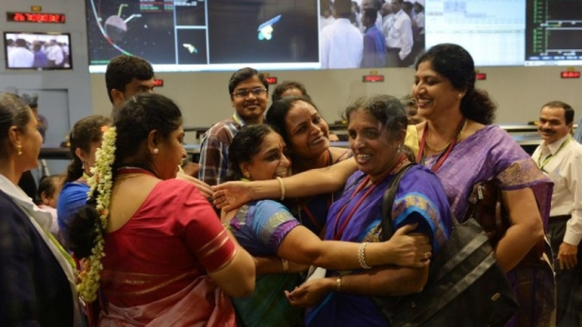 Staff from the Indian Space Research Organization celebrate at the ISRO Telemetry, Tracking and Command Network in Bangalore after their Mars Orbiter spacecraft successfully entered Mars orbit on September 24, 2014. Via PRI.