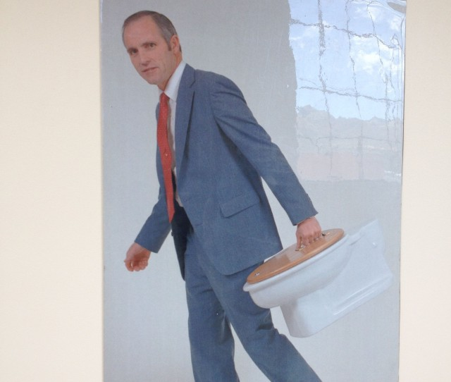 Photo of a Young Don Aslett carrying his toilet briefcase.
