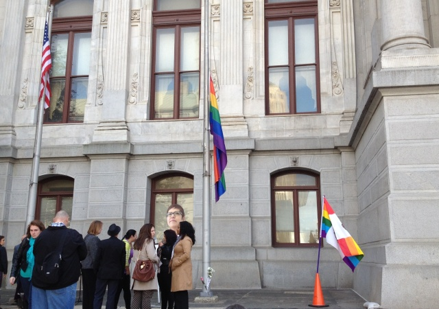 Community members gathered at City Hall to remember Casarez and lower the Rainbow Flag to half-mast.