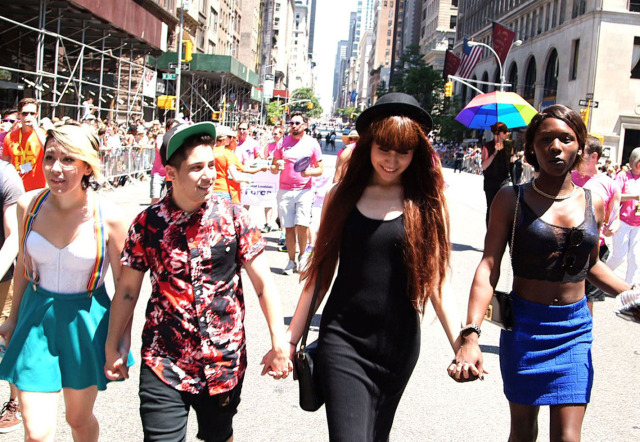 Some of the cast members marching in a Pride Parade via Look Different