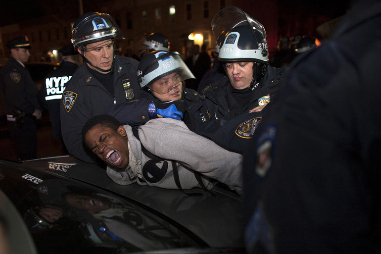 NYPD officers arrest a young man during a protest in the Brooklyn borough of New York