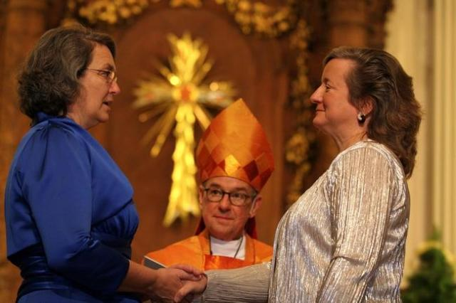 The 2011 marriage of two lesbian Episcopal priests marked one of many recent shifts in the relationship between queer people and the church. Photo via The Patriot Ledger