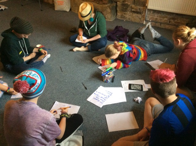A Young Women's Peer Health Project meeting inside the center image via Young Women's Peer Health Project