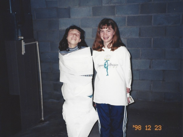 """Laura and Kate playing the """"mummy wrapping game"""" at Laura's 12th birthday party. Oswego, 1998."""