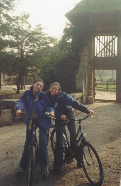 Laura and Kate riding bikes. We took Kate with us on our family vacation. Versailles, 2001.