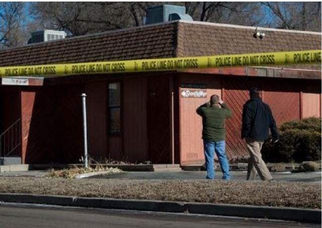 Colorado Springs police investigate the scene of an explosion Tuesday, Jan. 6, 2014, near the Colorado Springs chapter of the NAACP. (The Gazette, Christian Murdock)