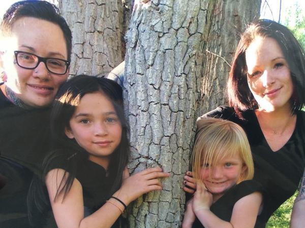 Vanessa Collier, far left, with her family. via The Denver Post