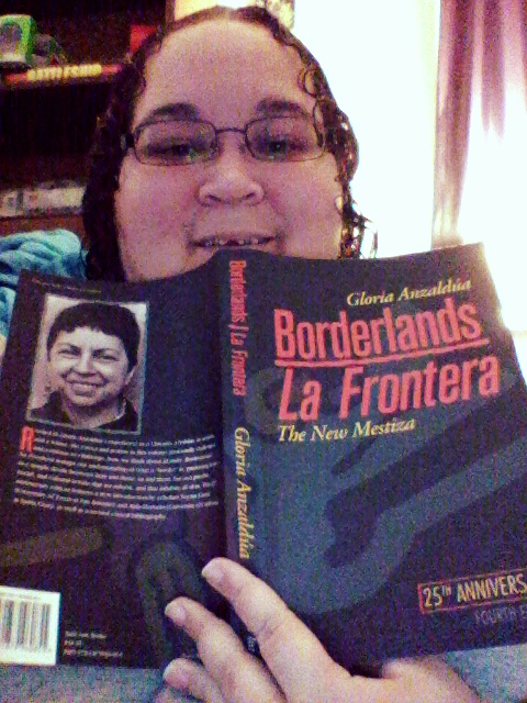 Dani reading Borderlands/La Frontera