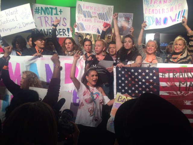 Protestors raise fists in solidarity. (image via The National LGBTQ Task Force)