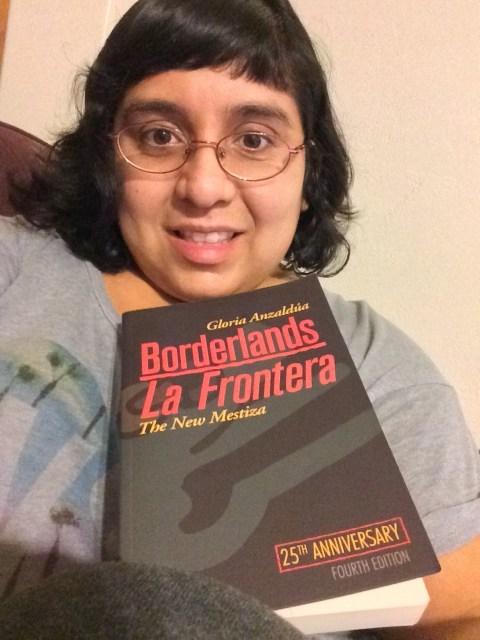 Maggie reading Borderlands.