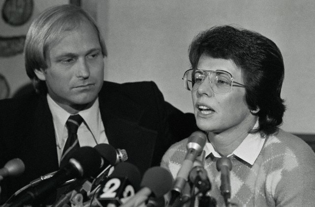 "Original caption: ""Tennis star Billie Jean King answers questions at a press conference here, in which she admitted that she carried on a homosexual relationship several years ago. The admission came as a result of allegations by Marilyn Barnett, a former hairdresser who claims she and Mrs. King were lovers. The suit says the former tennis star had promised to give Miss Barnett a Malibu, California, beach home."" (Image by © Bettmann/CORBIS)"