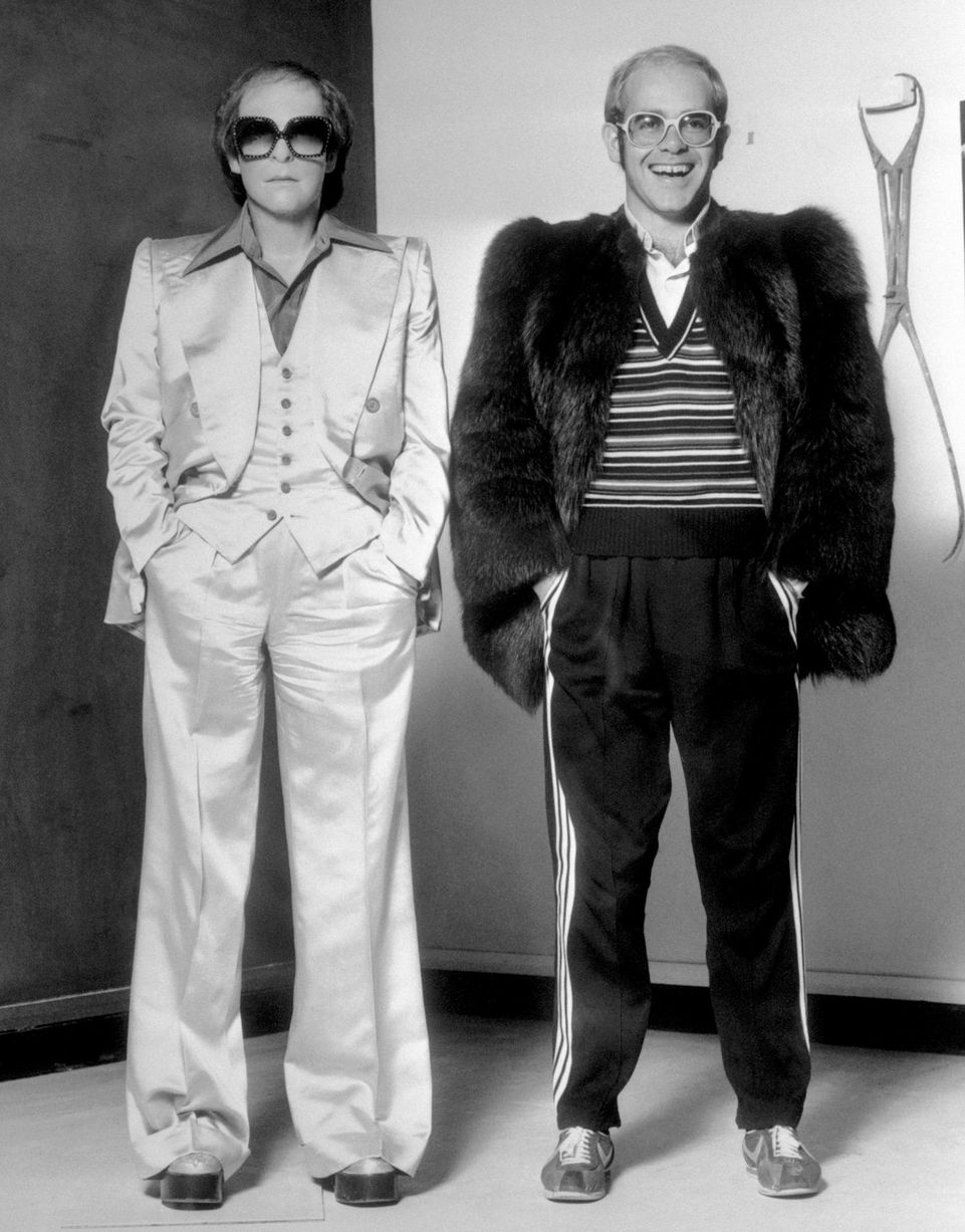 Elton John with his wax figure, 1976, via The Mirror