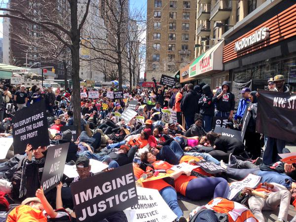Protesters stage a die-in outside a McDonalds in New York City to show that economic justice is racial justice via @FastFoodFoward Twitter