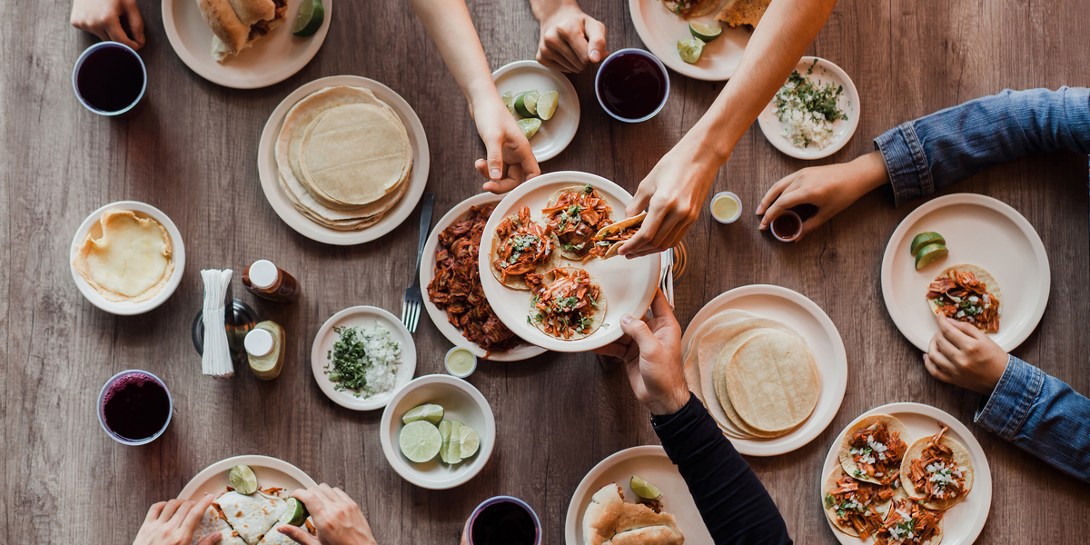 Big table of tacos and taco toppings, fillings etc