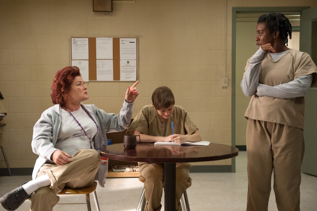 "L-R: Kate Mulgrew , Abigail Savage and Uzo Aduba in season 3 of Netflix's ""Orange is the New Black."" Photo Credit: JoJo Whilden/Netflix"