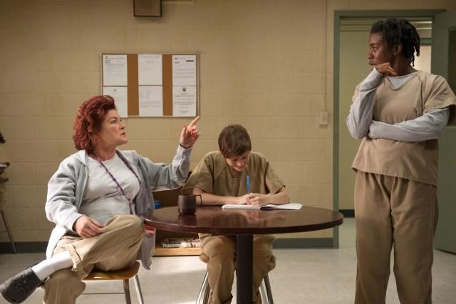 "L-R: Kate Mulgrew , Abigail Savage and Uzo Aduba in season 3 of Netflix's ""Orange is the New Black."" Photo Credit: JoJo Whilden/Netflix"