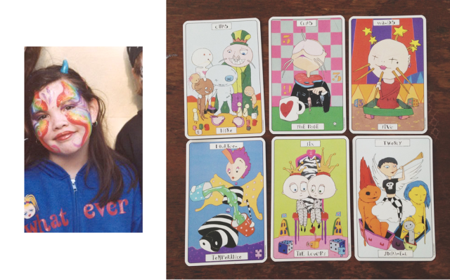 Cecelia as a baby witch and the Phantasmagoric Theatre Tarot.