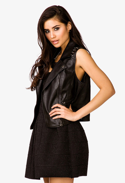 Forever 21 Moto Vest  (http://www.forever21.com/shop/ca/en/women-outerwear-sale/p/studded-faux-leather-moto-vest-2045208696?utm_source=opmpros&utm_medium=affiliate&utm_campaign=UBAokkJVcos&siteID=UBAokkJVcos-GgPMe942BVJn91n9u9PfOA)