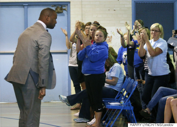 Image #: 36945118    Efland-Cheeks Elementary teacher Omar Currie turns to acknowledge the applause of his fellow teachers and parents after an impassioned speech in front of the school's media review committee in the school gym Friday evening, May 15, 2015 in Efland, N.C. Currie is at the center of a controversy of reading an approved gay-themed fable book to kids in his elementary class. Over two hundred turned out Friday to speak to the review committee on the issue of the controversial book read to children at the school. (Harry Lynch/News & Observer/TNS)       Raleigh News & Observer/ TNS /LANDOV