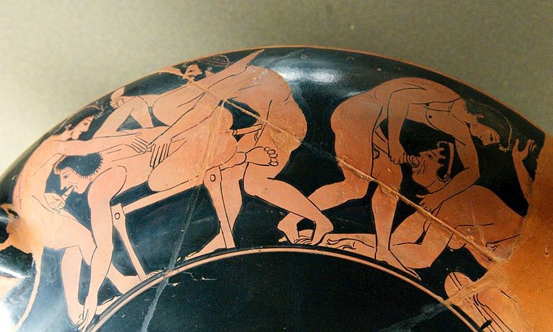 erotic scene on the rim of an ancient Greek drinking-cup, c. 510 BCE (Louvre)