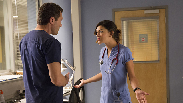 "COMPLICATIONS -- ""Outbreak"" Episode 104 -- Pictured: (l-r) Jason O'Mara as Dr. John Ellison, Jessica Szohr as Gretchen Polk -- (Photo by: Bob Mahoney/USA Network)"