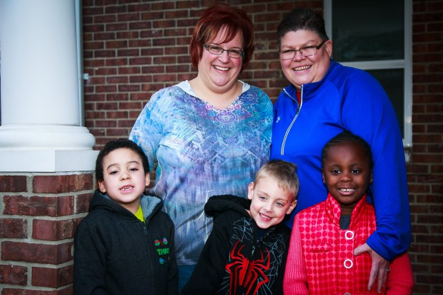 April DeBoer and Jane Rowse with three of their children, via GLAD
