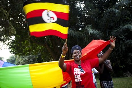An activist is holding the Ugandan flag during the first Gay Pride in Uganda, which took place at Entebbe beach on August 4, 2012.